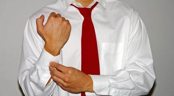 man doing up dress shirt cuffs