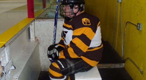 hockey player in penalty box