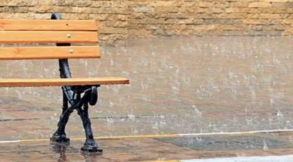 park bench in the rain